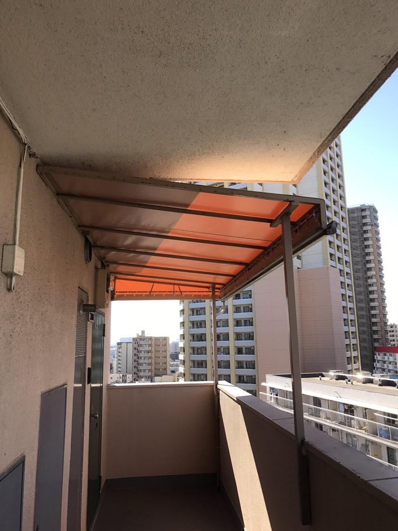 川口市でマンションの通路固定テント張替を行いました。